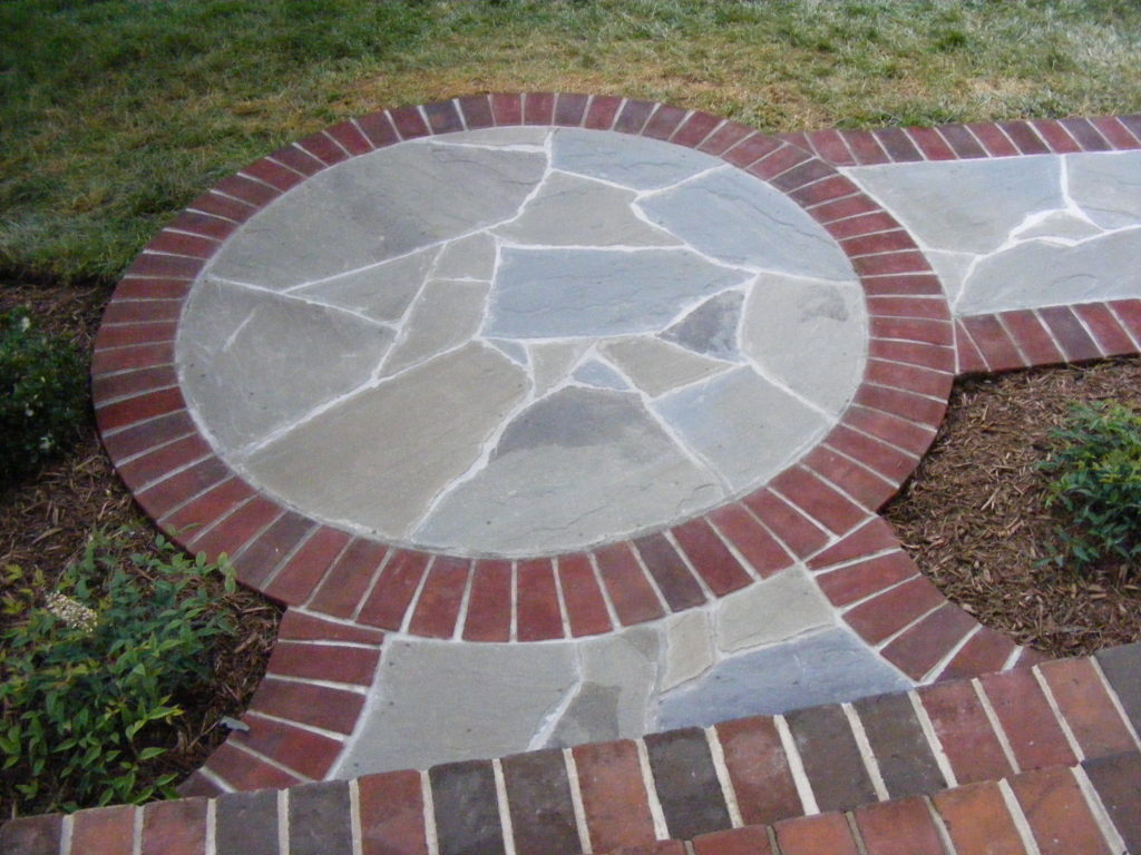 Circle landing with brick border